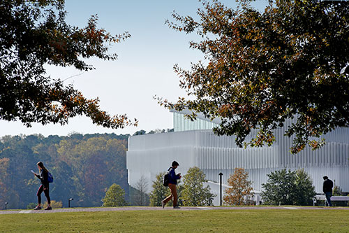 Students walking by the Centennial Campus at NC State
