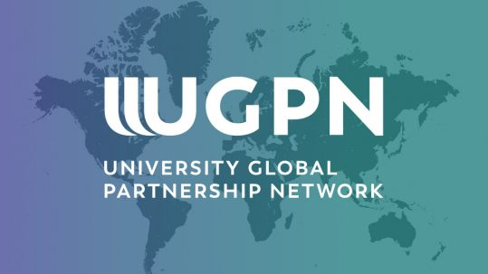UGPN logo superimposed on a globe illustration